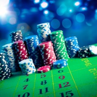 12820797-casino-chips-with-dramatic-lighting-and-lens-flares